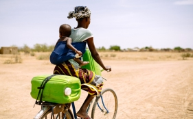 bf-hauling-water-on-bike-cifor-flickr