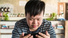 down-syndrome-boy-with-phone