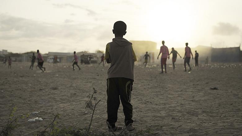 Boys Play Football Near IDP Camp in Mogadishu