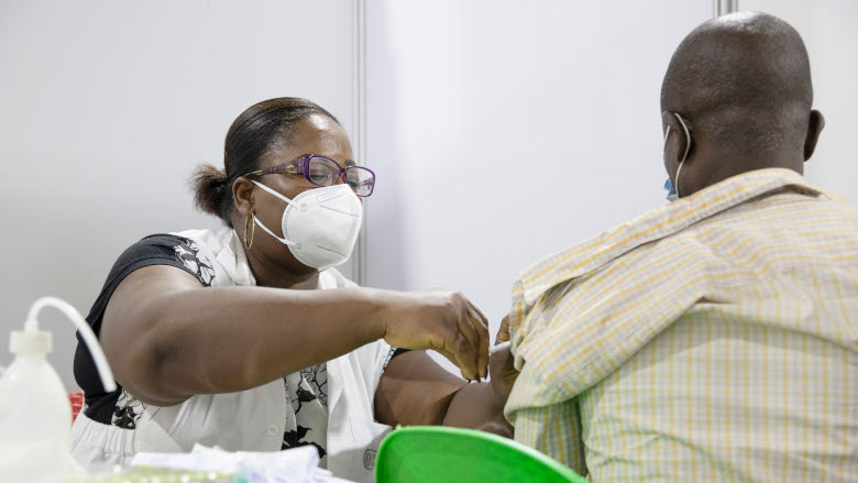 A man being vaccinated against COVID-19 at the vaccination cente